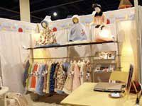 Sew What? Digitally Printed Logo Header, pipe and drape, custom trade show display, portable trade show display, trade show exhibit booth, drapery panel fabrics